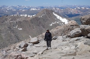 Tracie stands atop Mt. Evans